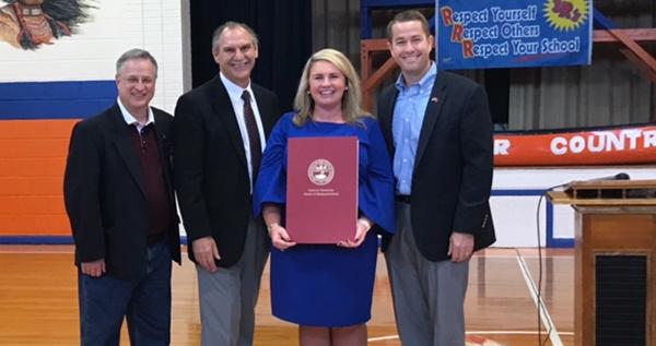 Boyd honors Woodland's Angela Cossey